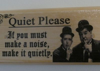 "Laurel and Hardy saying ""Quiet Please"""